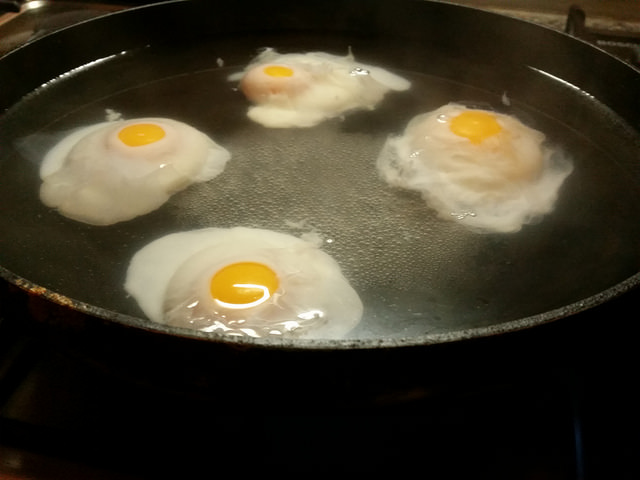 poached eggs in iron skillet